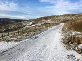 Old railway line trail on a snowy day